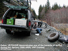 VE7DXG repairs flat tire during January 2005 VHF Contest