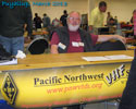 PNWVHFS at the Puyallup Ham Fair with Jim K7ND receiving Conference registrations.